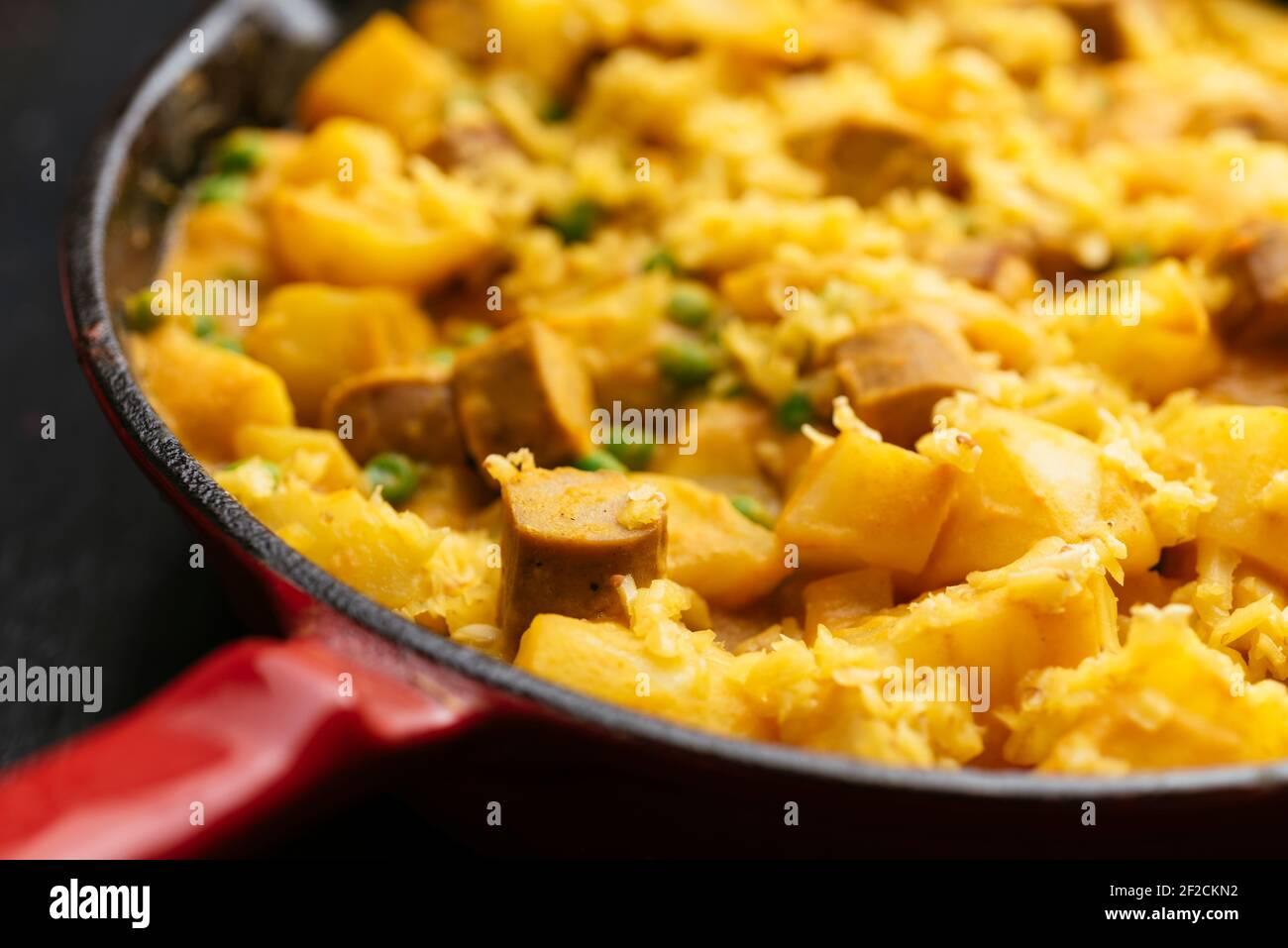 Vegan Hot Dog, Potato, Pea Dinner with Cheesy Sauce Stock Photo