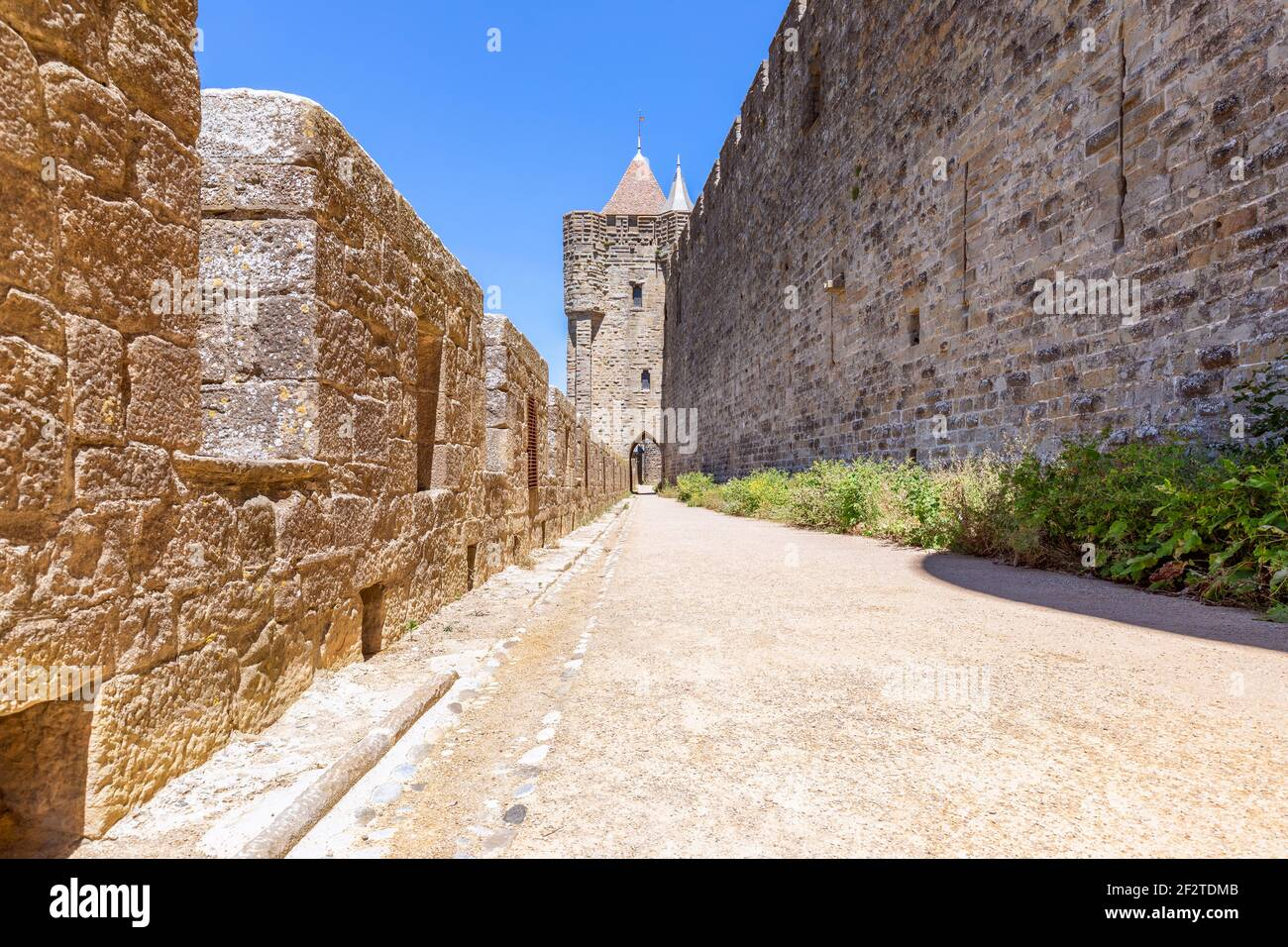 Wide fortified walls with walkways and arches of medieval castle of Carcassonne town Stock Photo