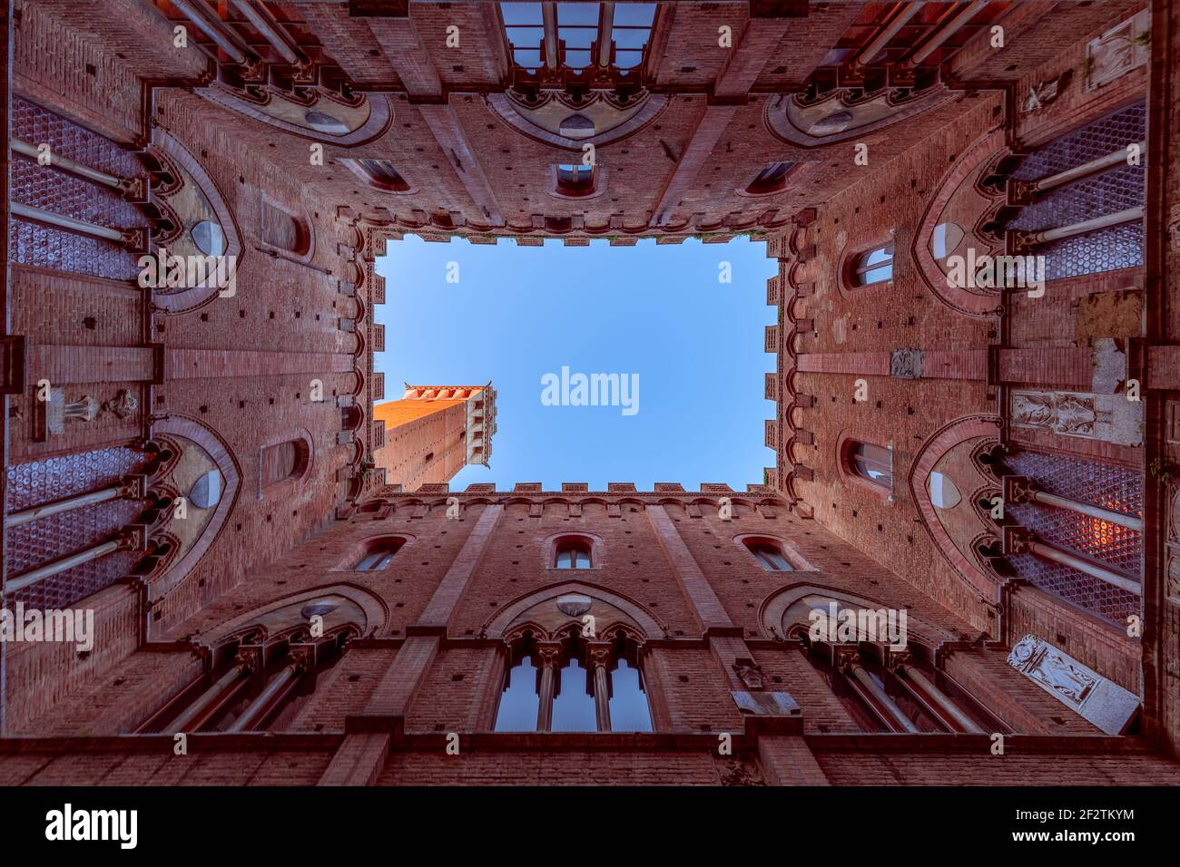Wide angle view from the courtyard of Palazzo Pubblico to the famous Torre del Mangia. Siena, Tuscany, Italy Stock Photo