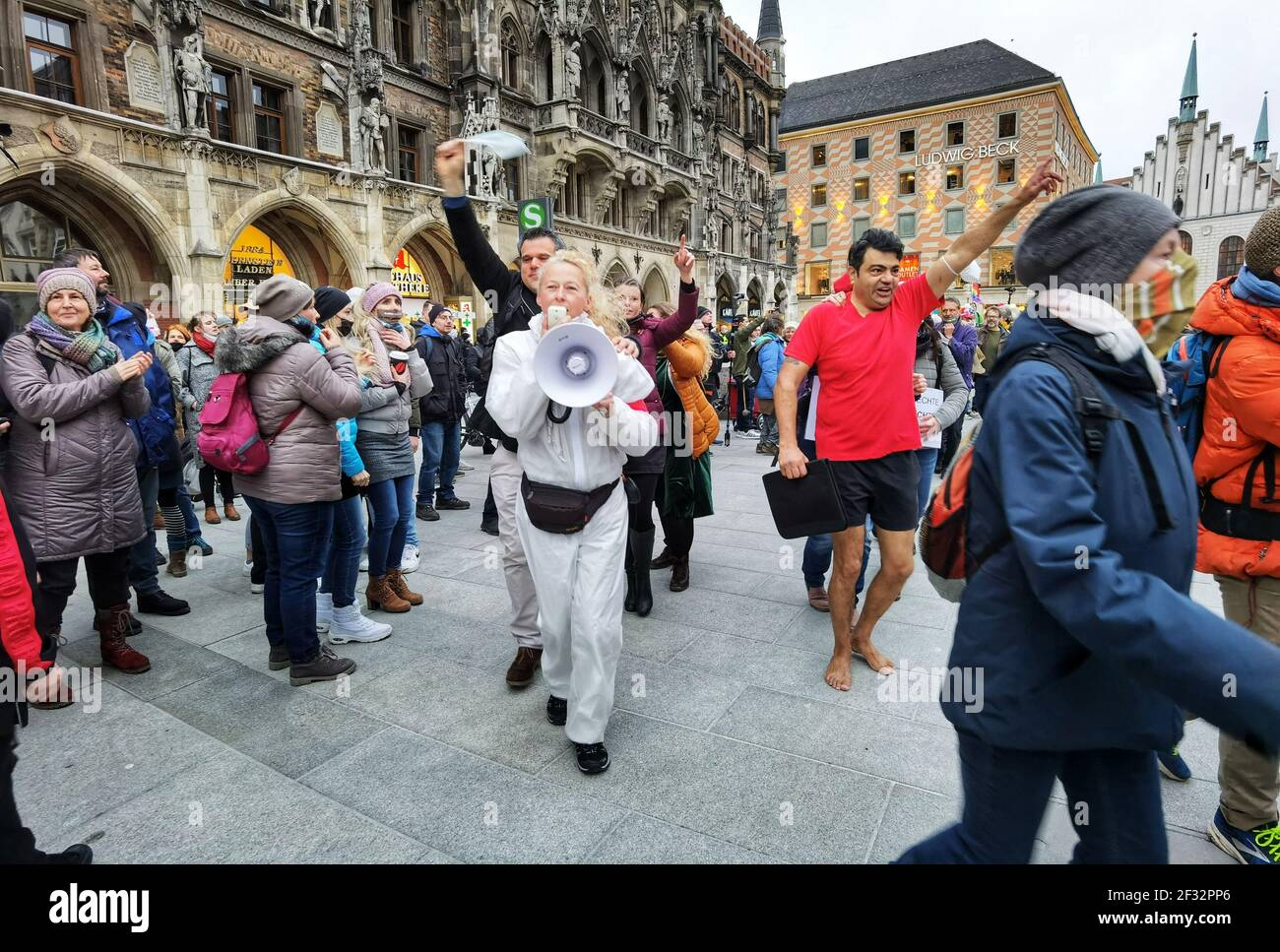 Munich, Bavaria, Germany. 14th Mar, 2021. Corona deniers and anti-maskers partake in a Polonaise dance- without distancing and most without masks at Munich's Marienplatz. Despite rising British variant Corona numbers, police maintained a laid-back approach. Using the occasion of Germany going into a period of anti-Corona measures approximately one year ago, Corona deniers and anti-maskers led by Querdenken's Markus Haintz assembled at Munich's Marienplatz and then at the Maxmonument in an effort to protest against the Bavarian Landtag and promote their initiative to dissolve it Stock Photo