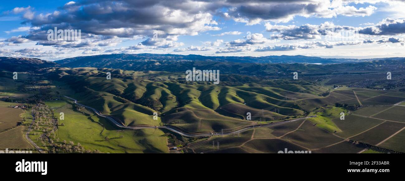 Low clouds drift over a green, peaceful landscape in Livermore, California. Some of the world's best vineyards exist in this Bay Area region. Stock Photo