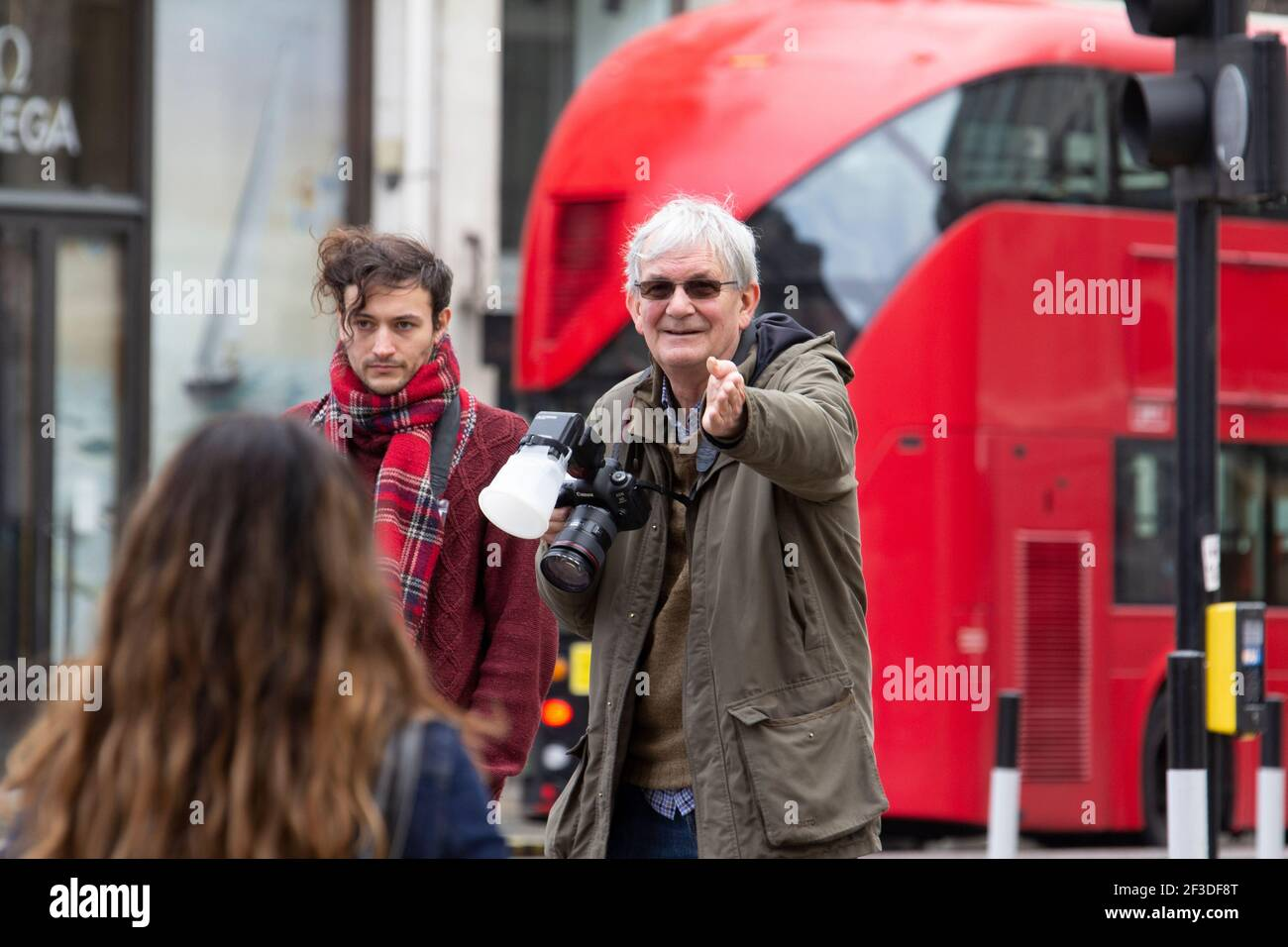 Martin Parr photographer at work in Oxford Street London, Martin Parr is a British documentary photographer, and  photojournalist Stock Photo