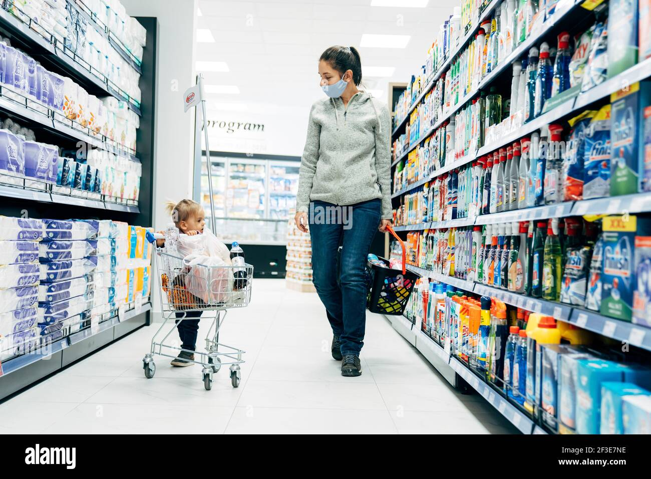 Budva, Montenegro - 17 march 2021: A child with a small trolley in the  supermarket, go shopping with his mother. The family goes shopping Stock  Photo - Alamy