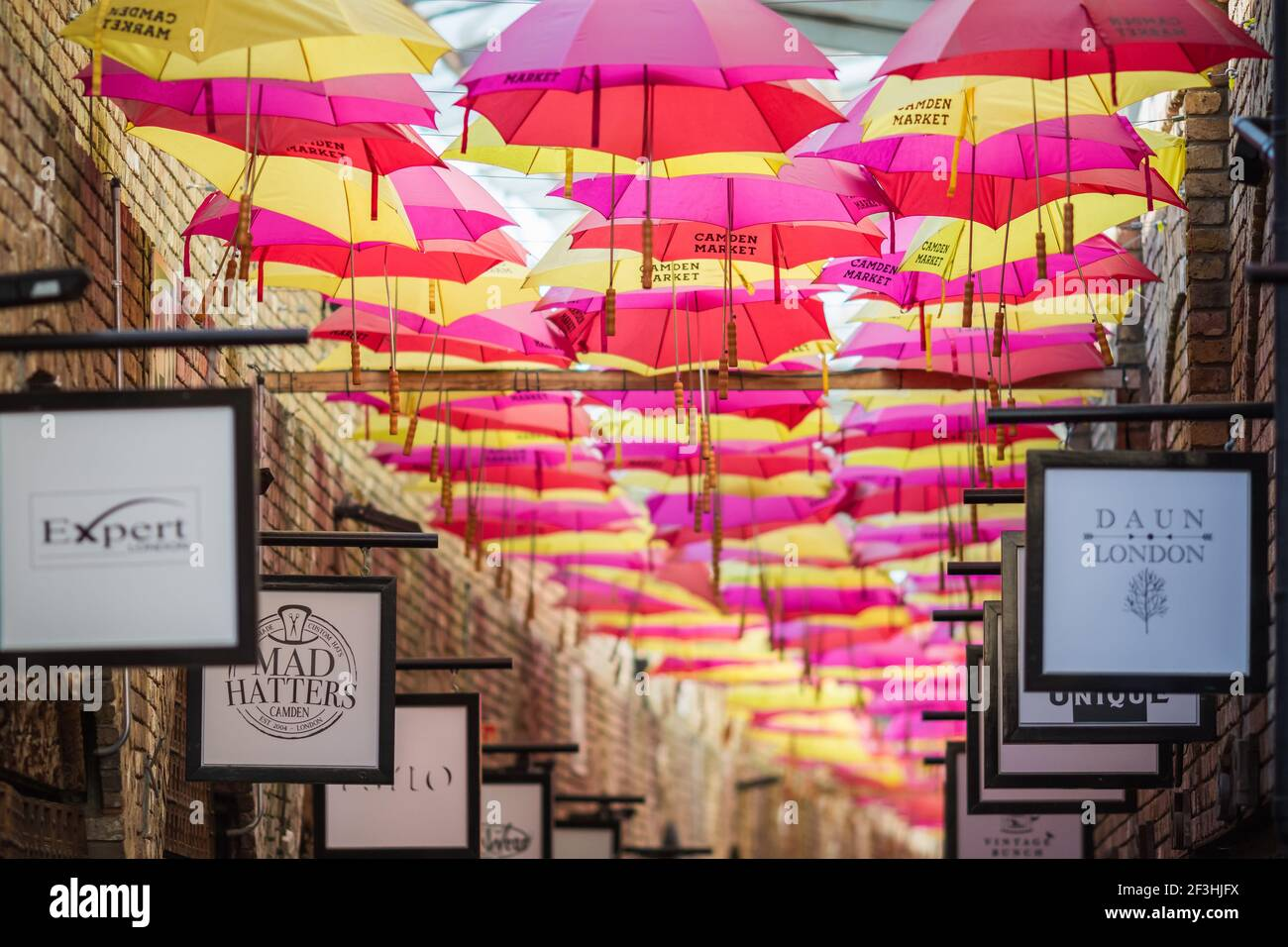 London, UK - 26 February, 2021 - The colourful umbrella alley in Camden stables market Stock Photo