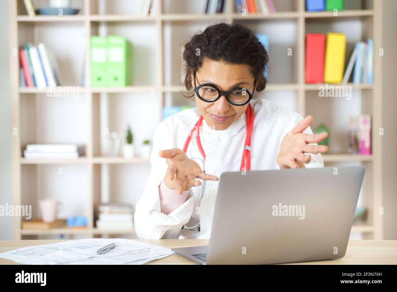 Doctor helping patient via telehealth making video call Stock Photo
