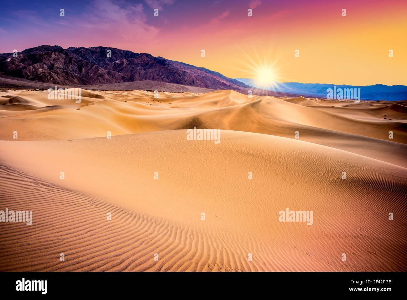Death Valley, California sand dunes with colorful sunset Stock Photo
