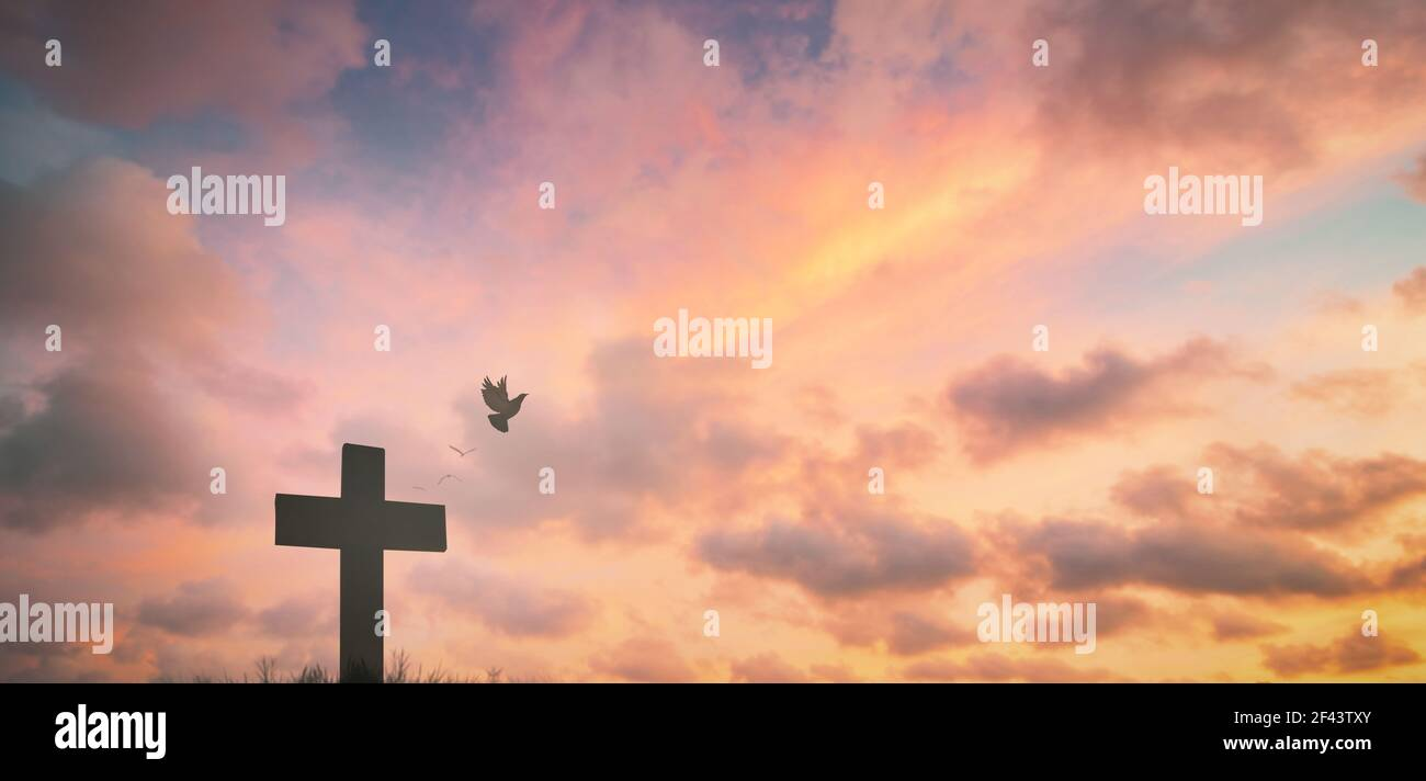 Silhouette jesus christ crucifix on cross on calvary sunset background concept for good friday he is risen in easter day, good friday worship in God, Stock Photo