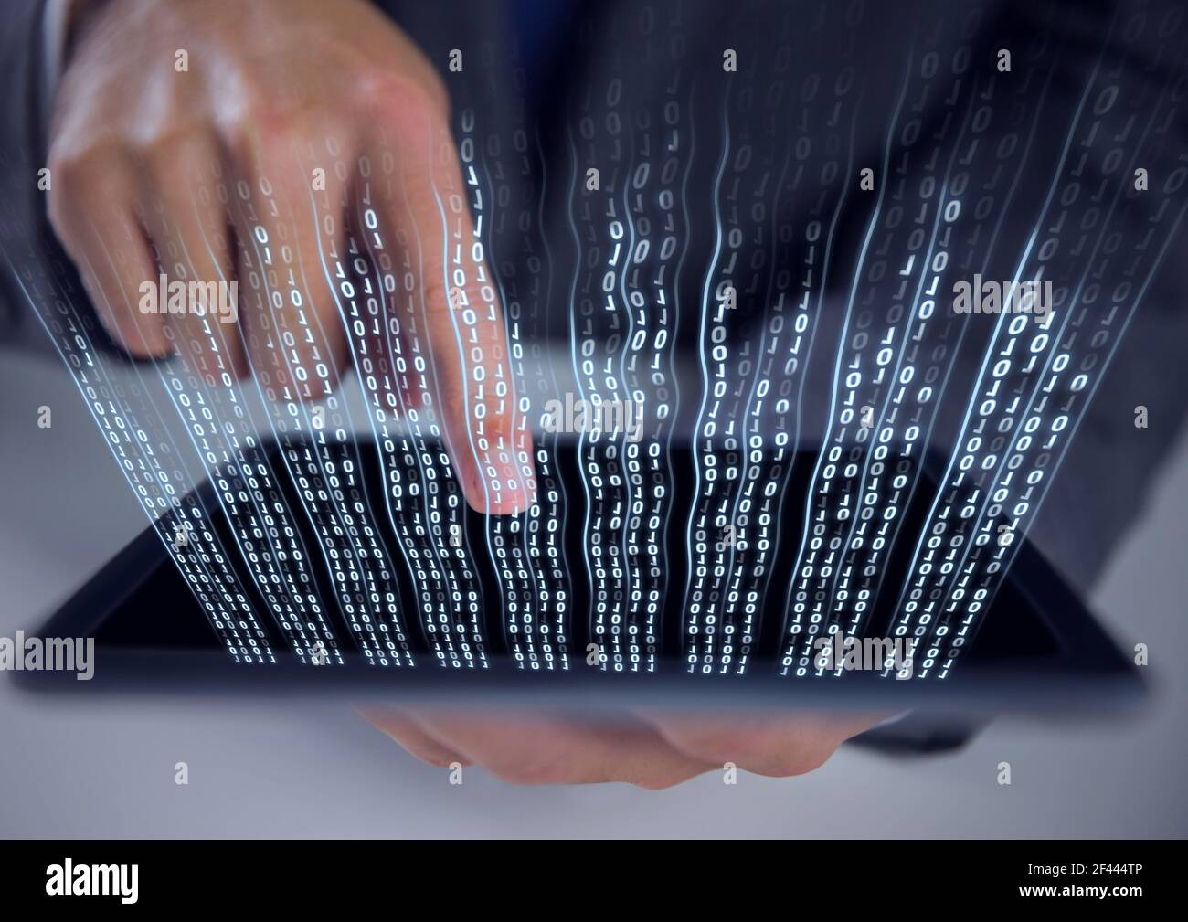 Composition of binary coding over man using tablet Stock Photo