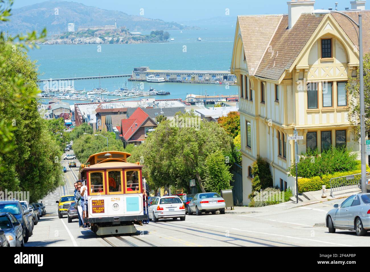 Powell-Hyde line cable car with Alcatraz Island in the background, San Francisco, California, USA Stock Photo