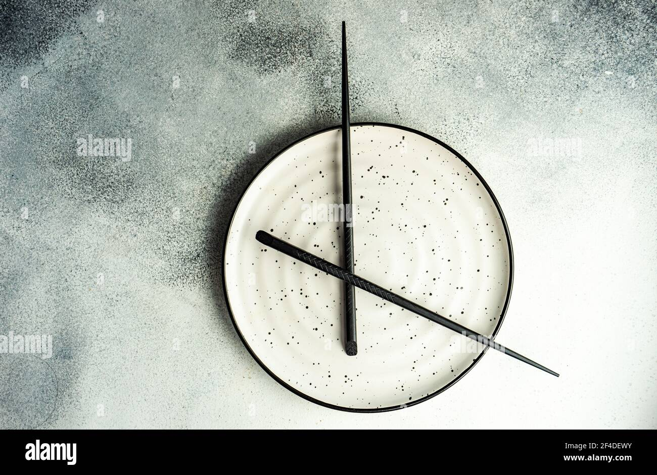 Minimalistic intermittent fasting concept Stock Photo