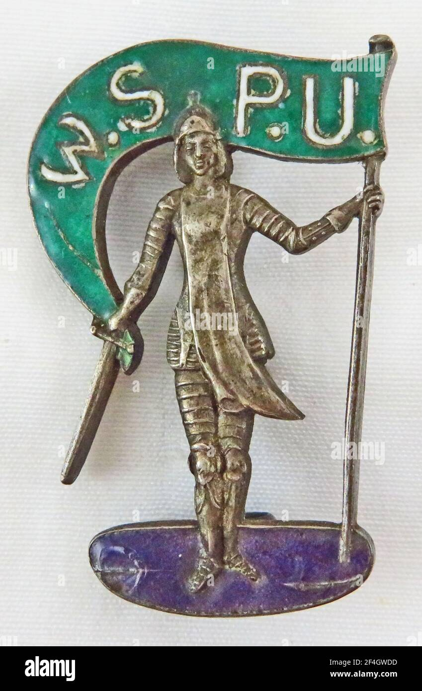 Pin depicting Joan of Arc, a symbol of the women's suffrage movement, issued by the militant women's suffrage group Women's Social and Political Union, United Kingdom, 1910. Photography by Emilia van Beugen. () Stock Photo