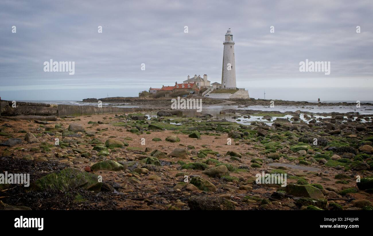 St Mary's Lighthouse stands on St Mary's Island just off the North Sea coast at Whitley Bay in North-East England. Stock Photo
