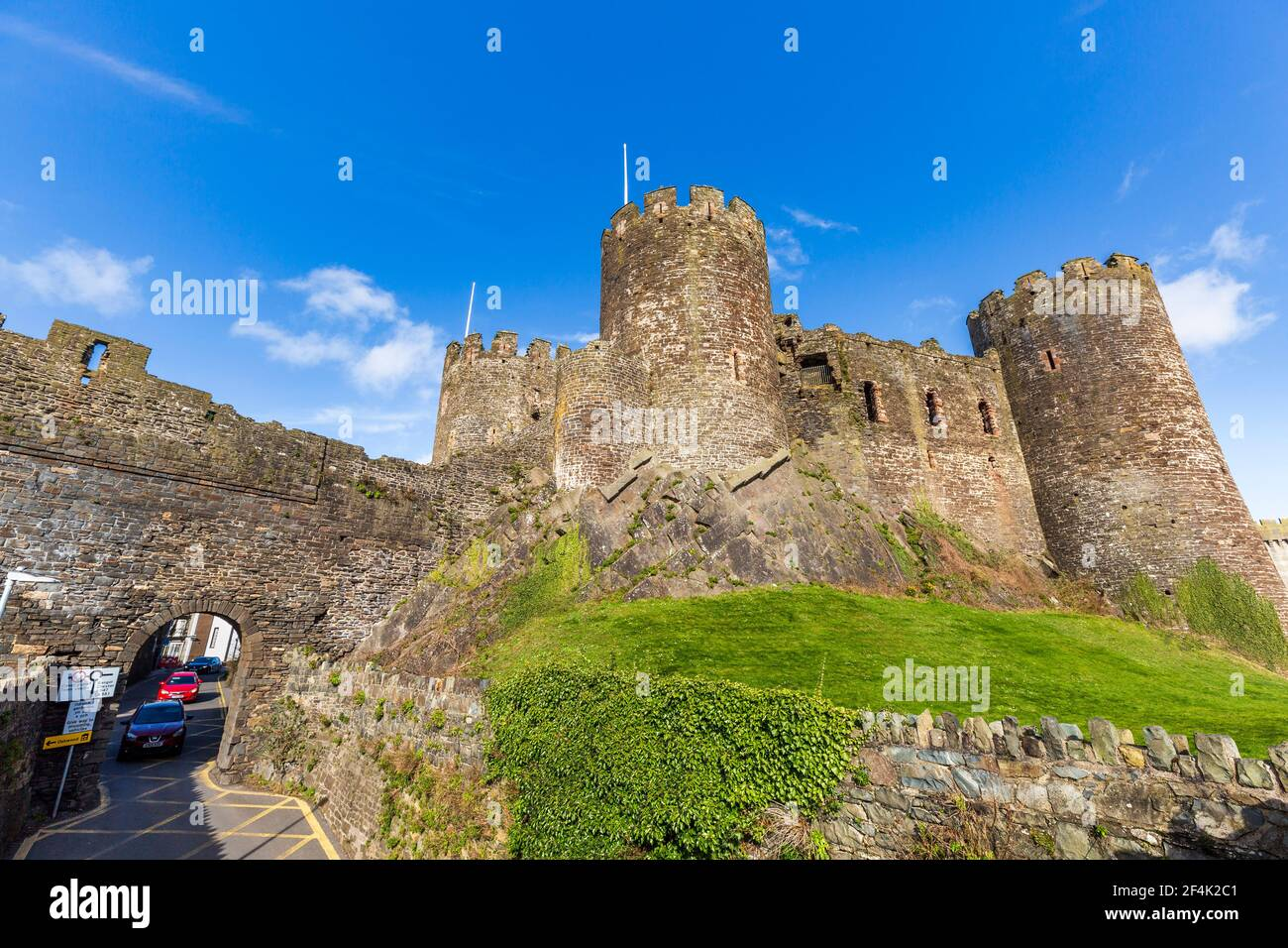 The town road through the castle walls at Conwy, Wales Stock Photo