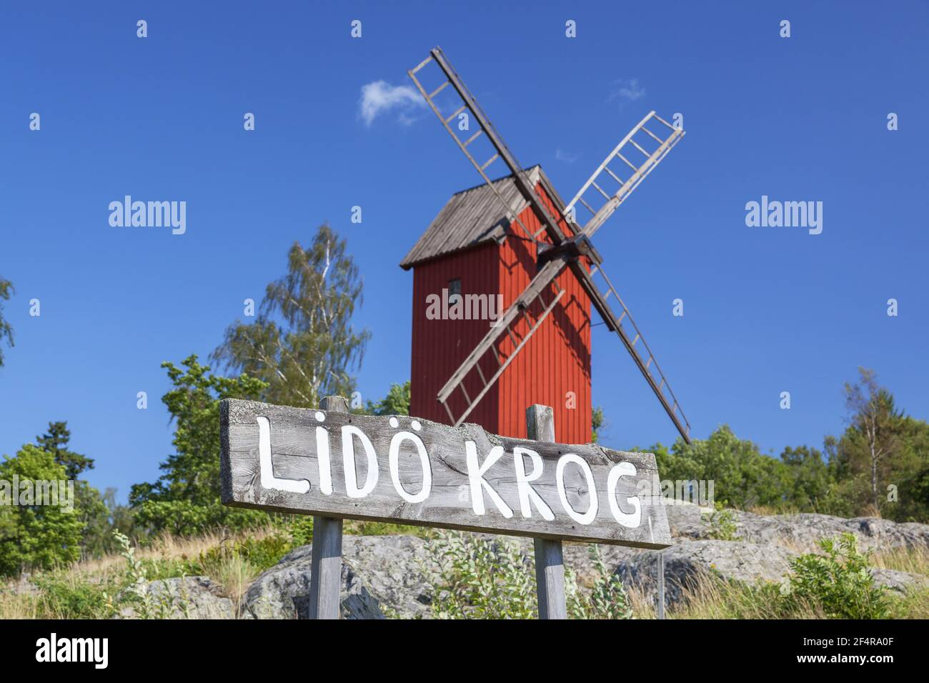geography / travel, Sweden, Stockholm laen, Stockholm skaergård, red post mill in front of the Lido Kr, Additional-Rights-Clearance-Info-Not-Available Stock Photo