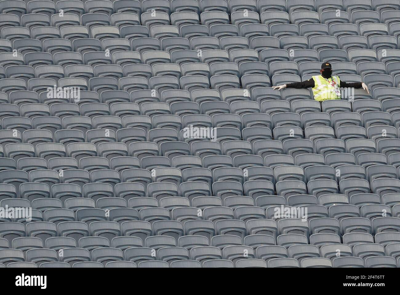 Cricket - First One Day International - India v England - Maharashtra Cricket Association Stadium, Pune, India - March 23, 2021  A member of security staff sits in the stands  REUTERS/Francis Mascarenhas Stock Photo