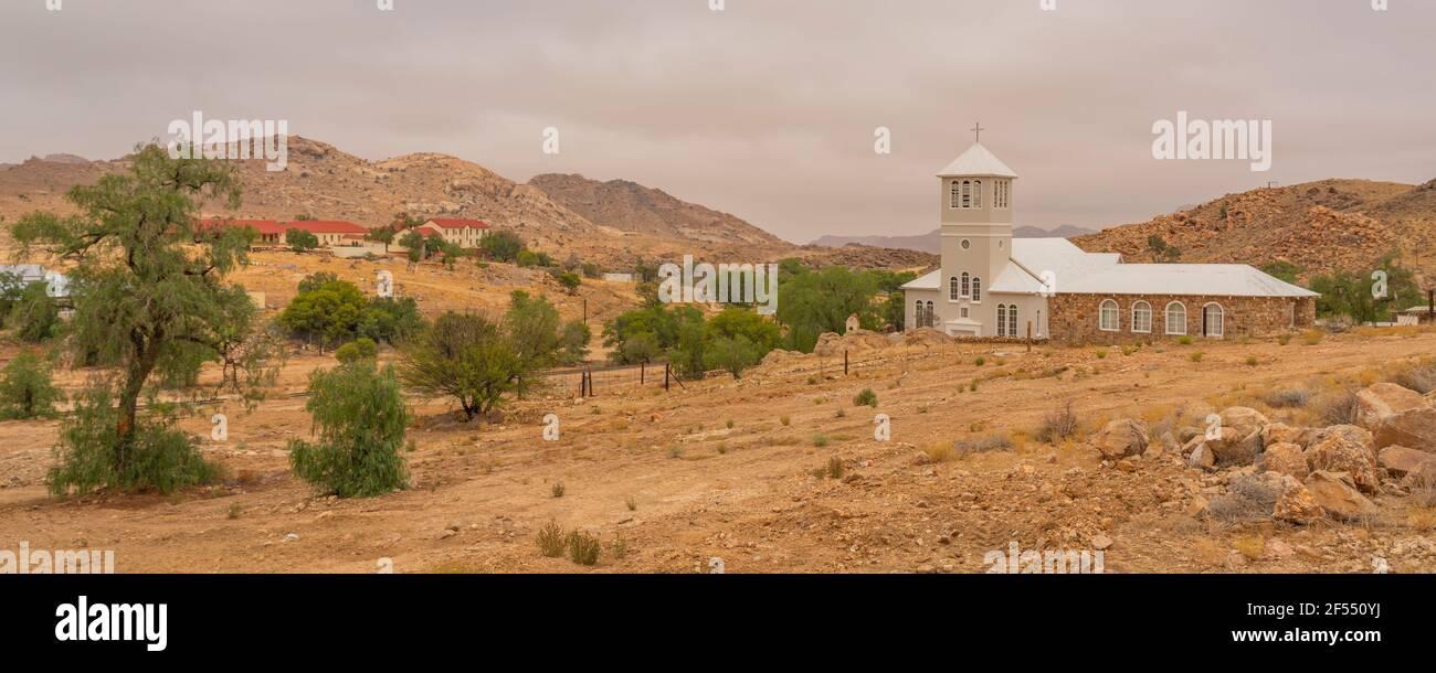 White Church from Town Aus, Namibia, background cloudy sky, Namib Naukluft Rand Stock Photo