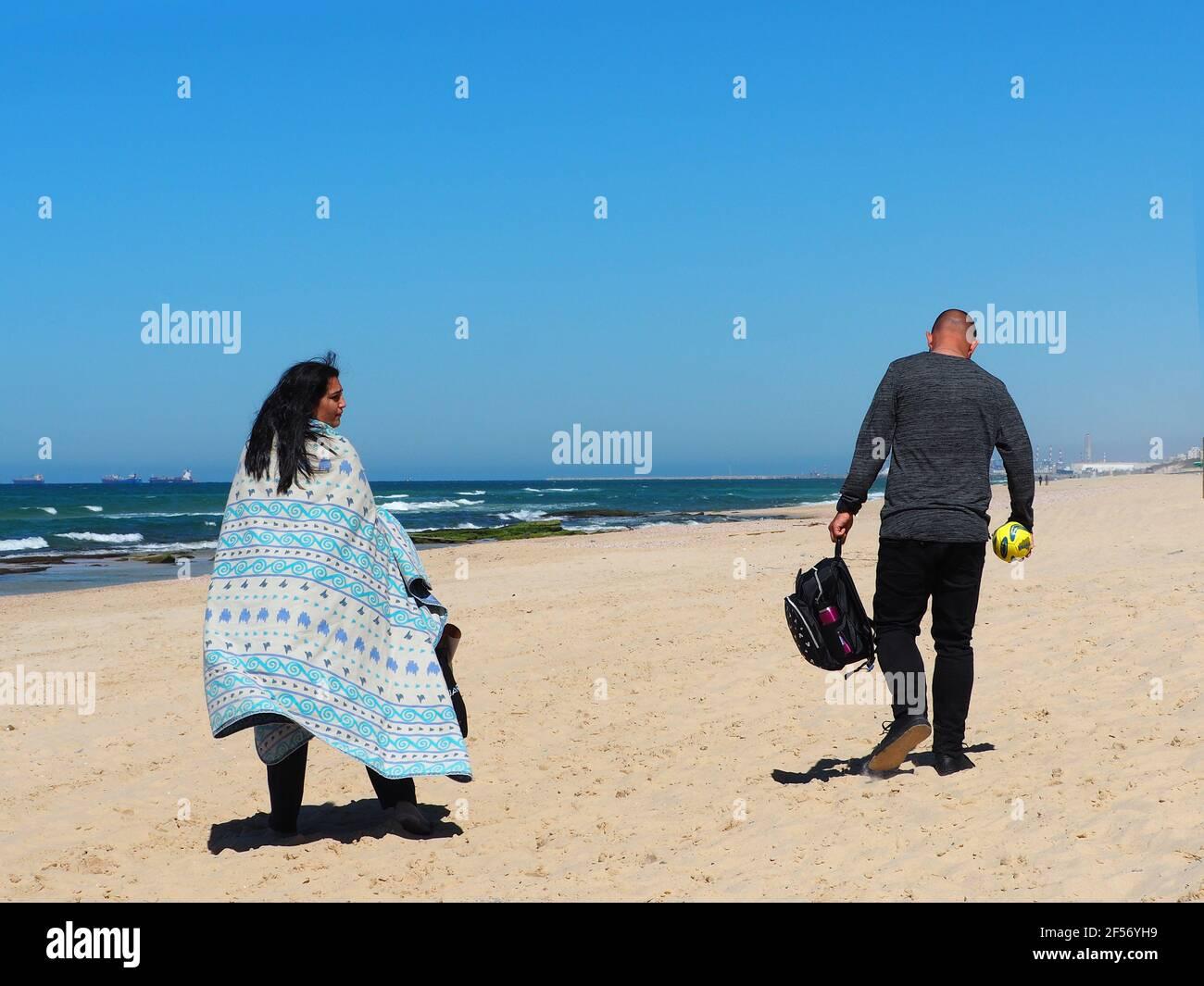 Nitzanim beach, Israel - 6 March, 2021: Family couple on the beach. Stock Photo