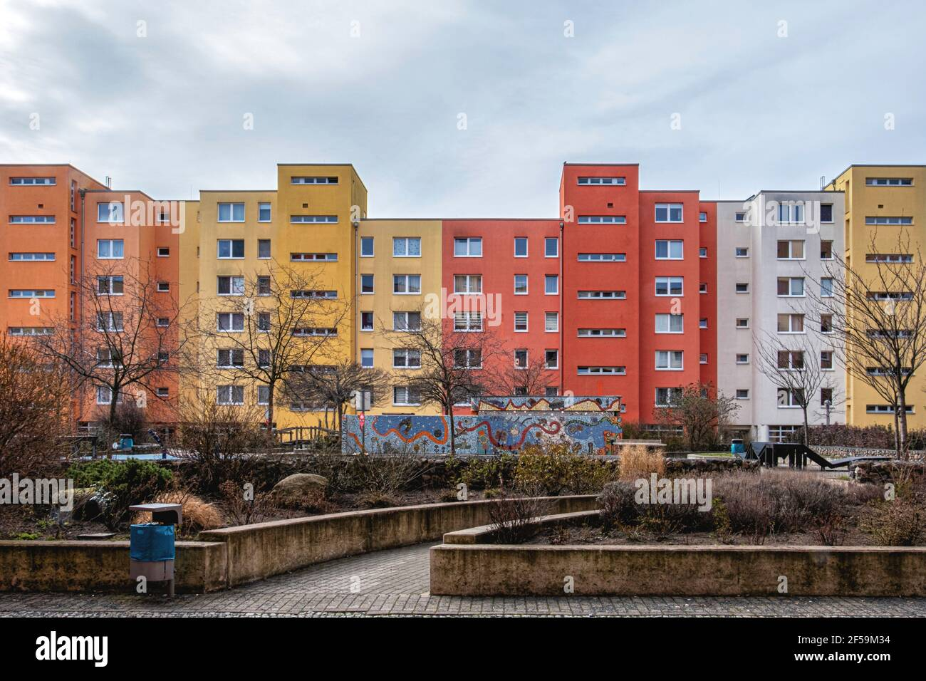 Colourful social housing apartment buildings with garden and mosaic in Graunstrasse, Gesundbrunnen, Berlin Stock Photo