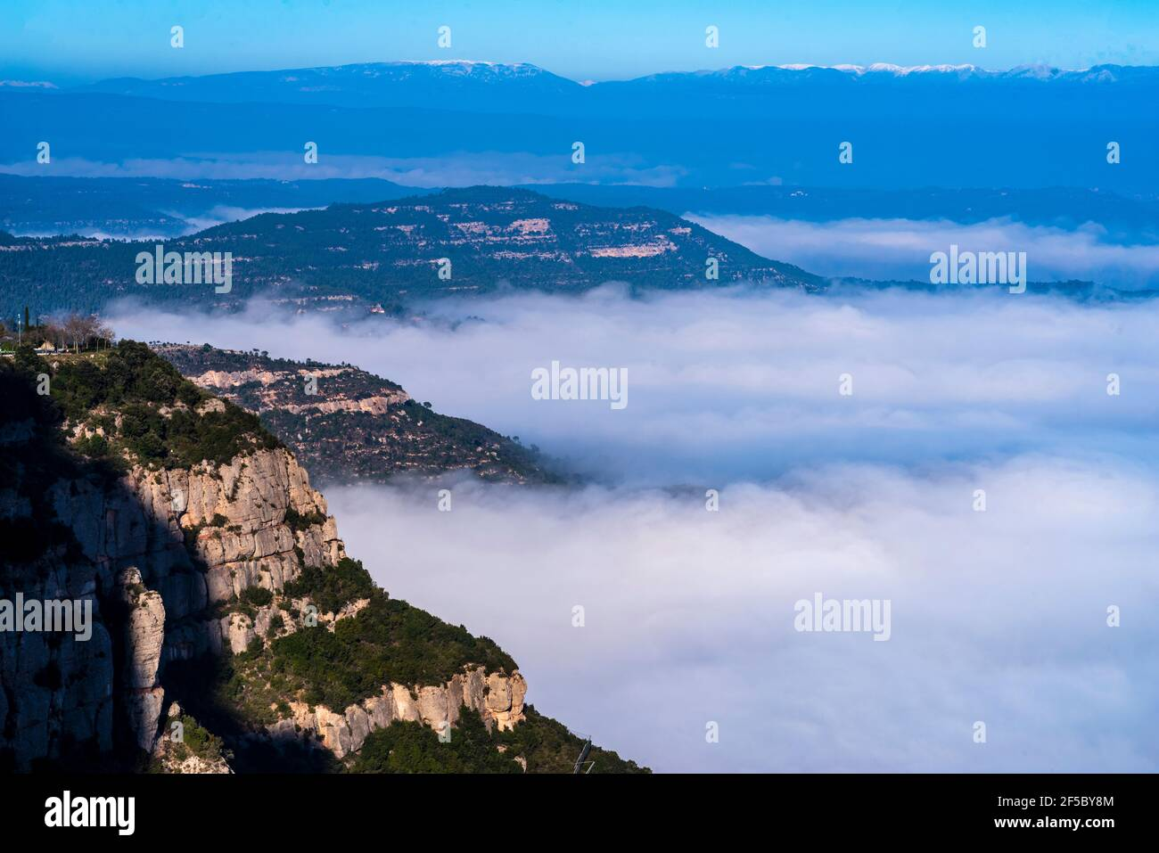 Mountain and basilica of Montserrat, Aerial view of central Catalonia, Manresa area, Barcelona, Catalonia, Spain. Stock Photo