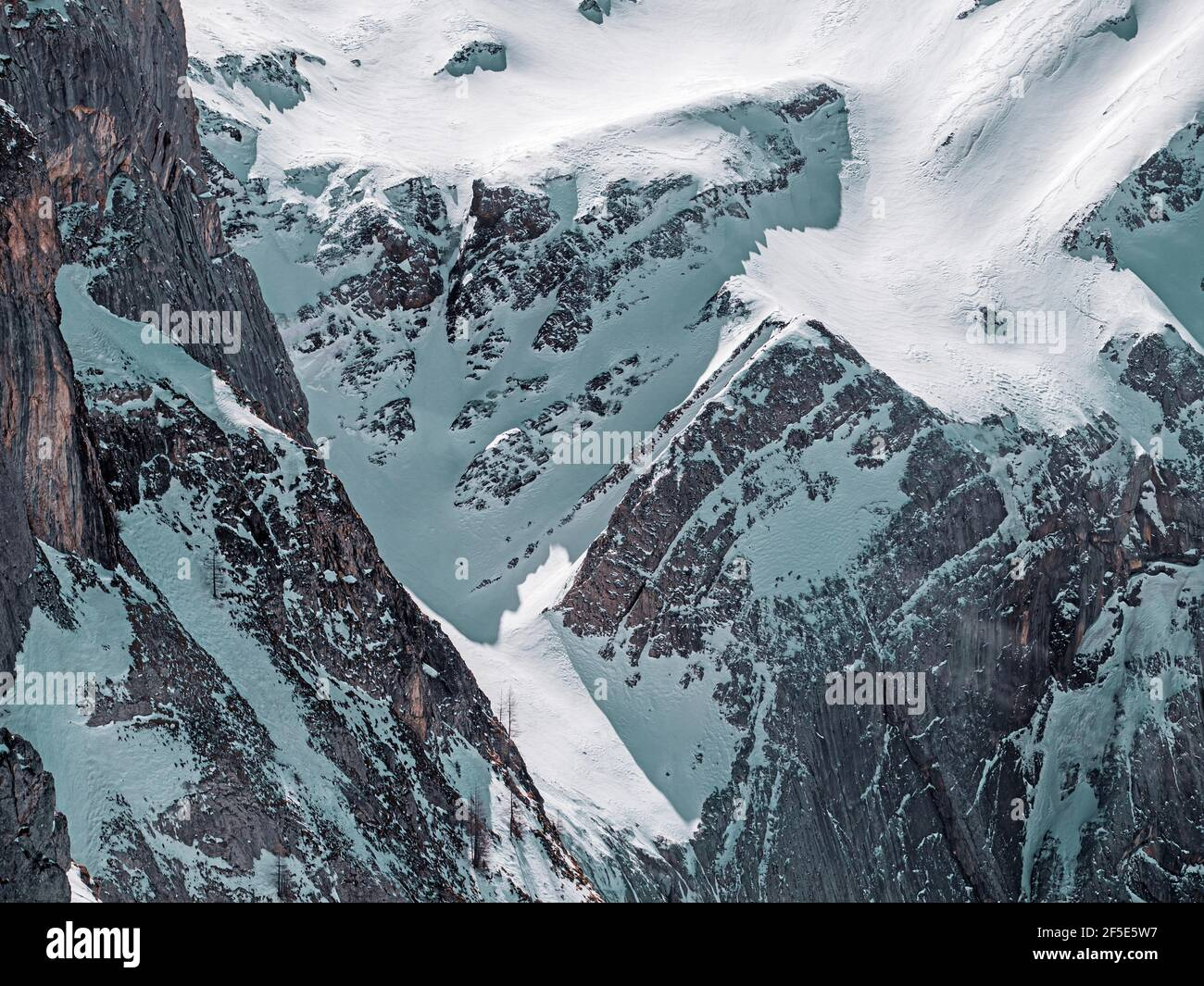 Beautiful alpine snow covered peaks in the mountain village of Les Diableret in Switzerland. Stock Photo