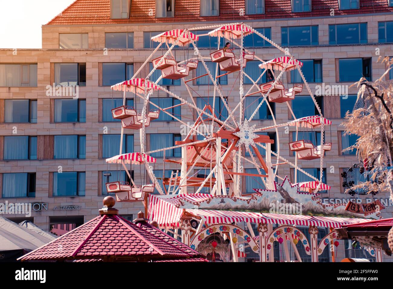 17 May 2019 Dresden, Germany - Ferris wheel at Altmarkt in morning. Trade center on background. Stock Photo