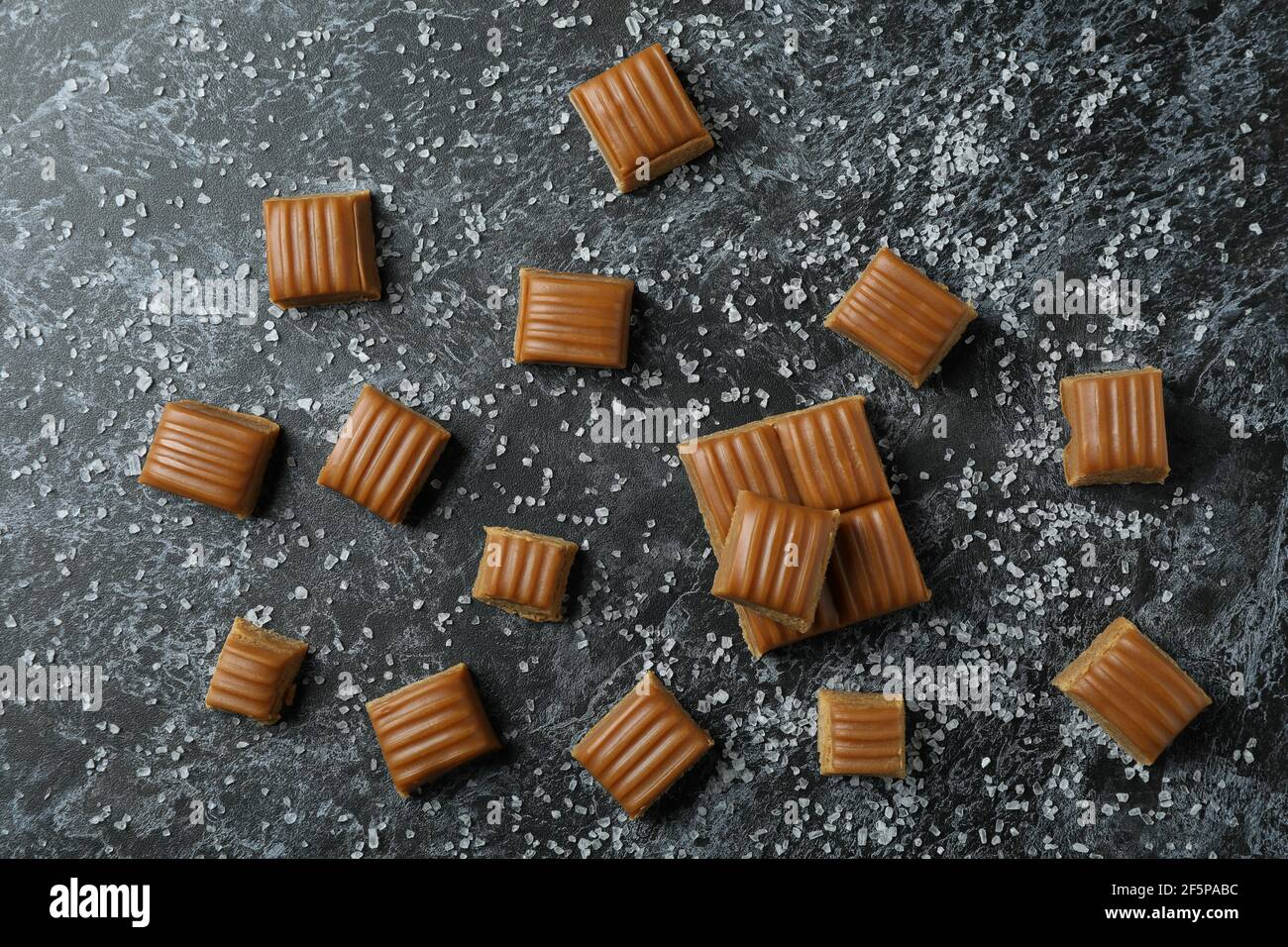 Salted caramel pieces on black smoky background Stock Photo