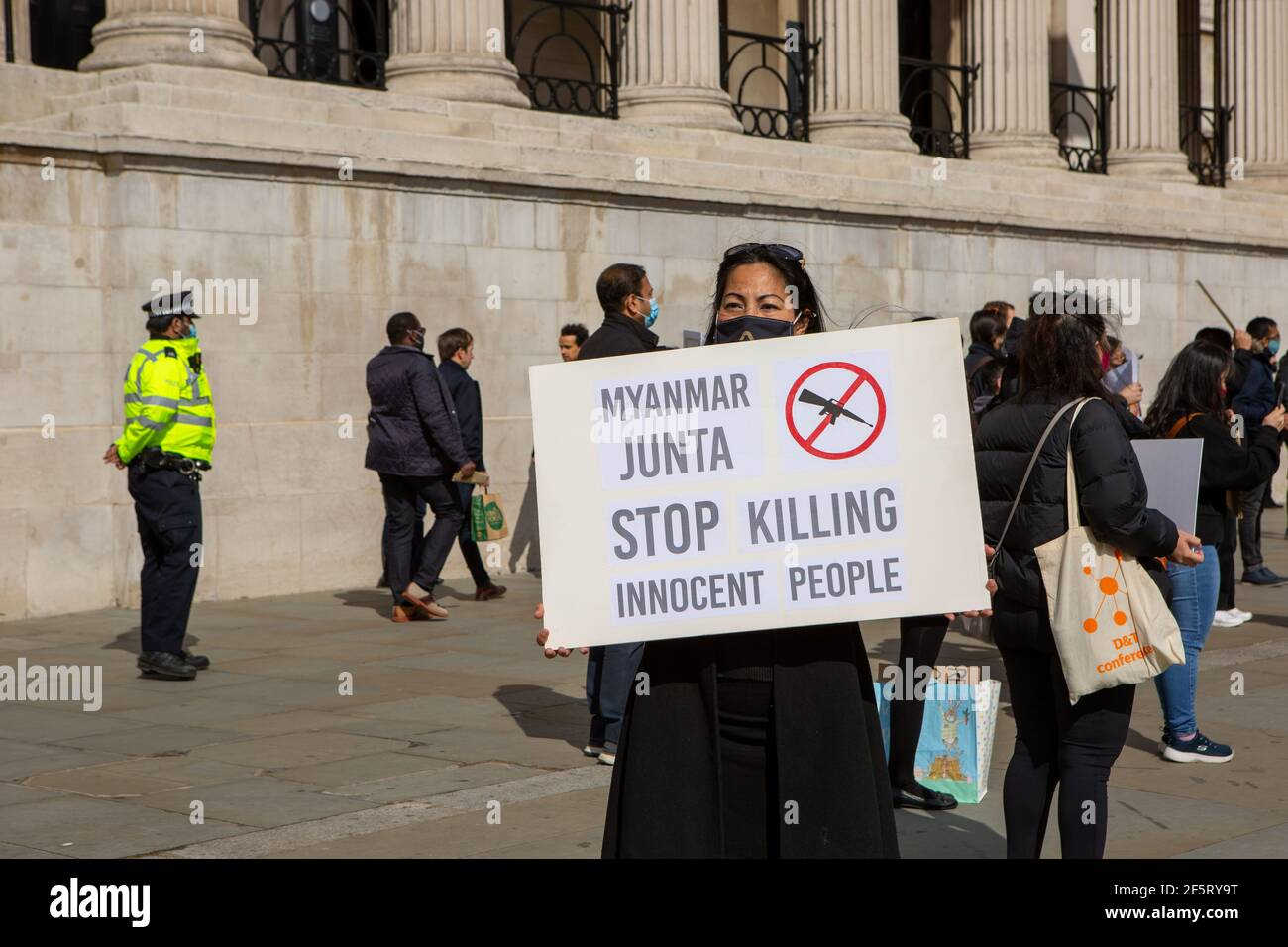 A protester holding a placard expressing her opinion during a peaceful demonstration.Myanmar anti military coup protesters gathered at Trafalgar Square as dozens more are killed in the country. Myanmar police and military soldiers (tatmadow) attacked protesters with rubber bullets, live ammunition, tear gas and stun bombs in response to anti-military coup protesters on Saturday in Myanmar, killing more than 90 people and injured many others. At least 300 people have been killed in Myanmar since the 1 February coup, a UN human rights official has said. Myanmar's military detained State Counsell Stock Photo