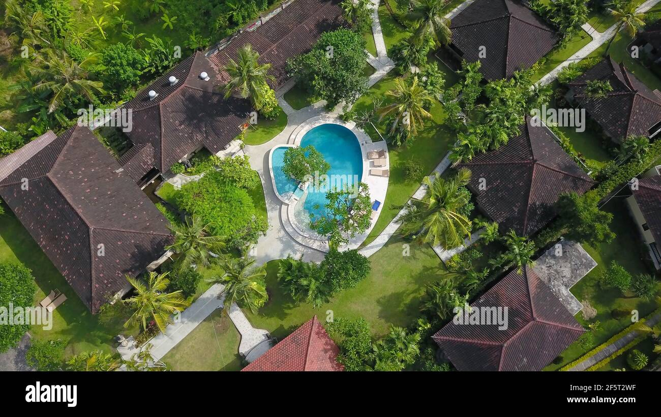 Amazing Luxury resort in Indonesia. Drone View of large villa with massive beautiful pool tucked within lush greenery and perched on a cliff in Nua Stock Photo
