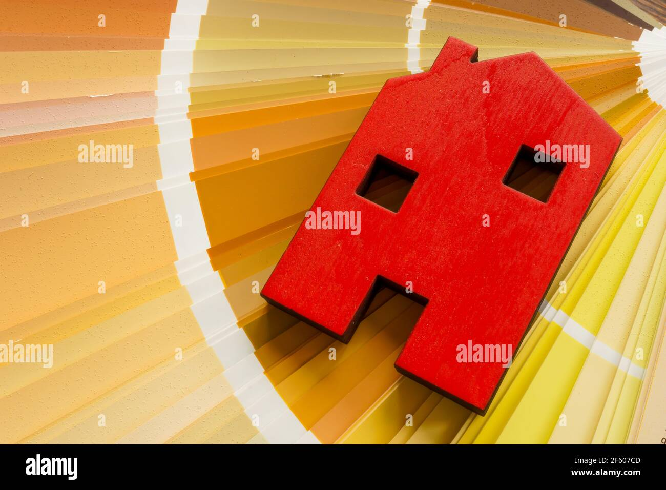House model on a color palette for renovation painting. Stock Photo