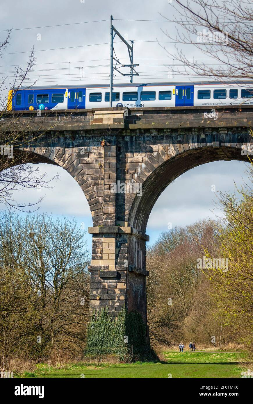 A Northern Rail train crossing the Sankey viaduct at Earlestown over the Sankey Valley. Stock Photo