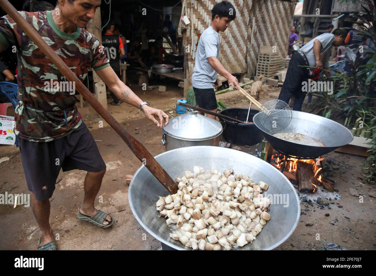 Izzie, 49, former Karenni Army (KNPP) cooks during a death anniversary in the Kayan village where people, who fled from Myanmar during the 1990s war between Myanmar's army and ethnic army groups, live in Mae Hong Son, Thailand March 25, 2021. Picture taken March 25, 2021. REUTERS/Soe Zeya Tun Stock Photo