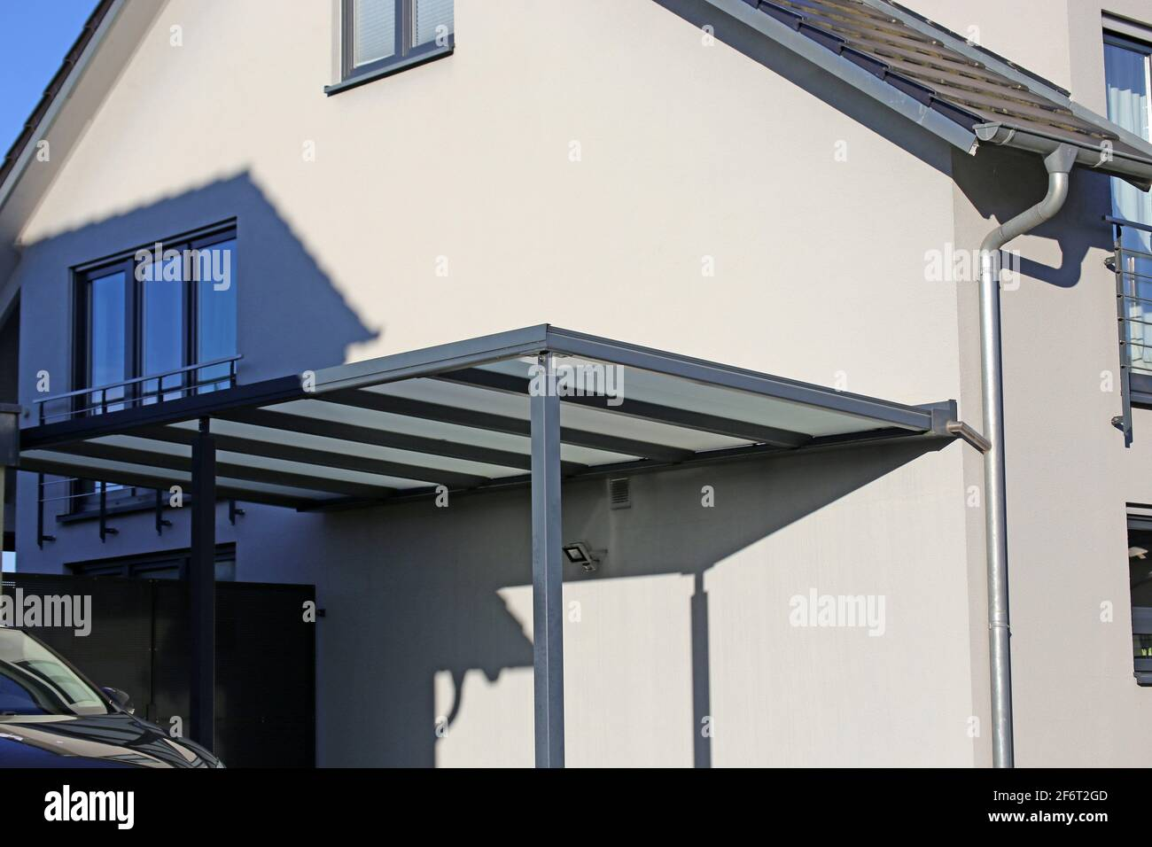 Modern and high quality carport at a single family house. Stock Photo