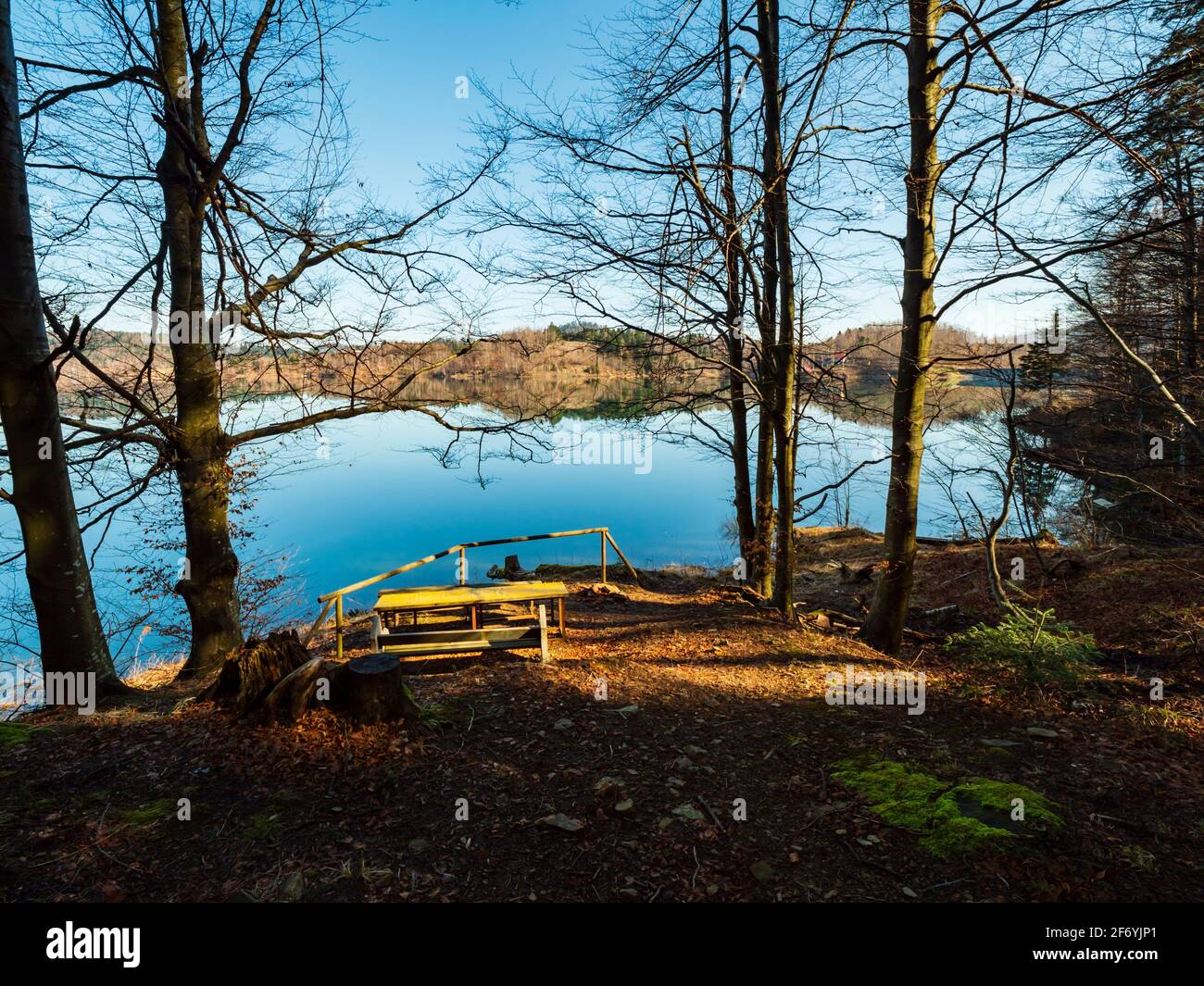 Picnic place wooden bench for zen in Lokve lake in Croatia Europe Stock Photo
