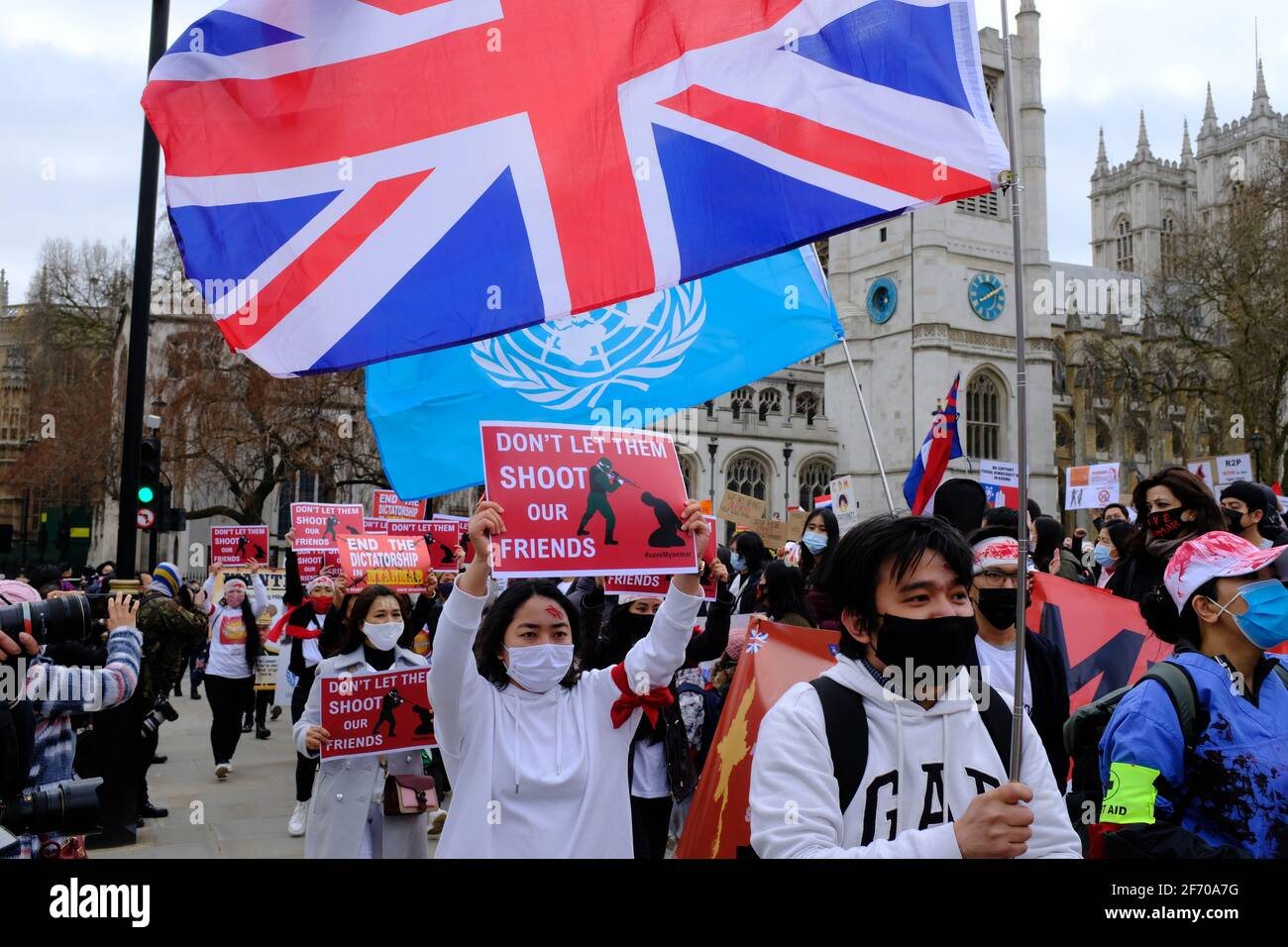 LONDON - 3RD APRIL 2021: Protesters on Parliament Square against the Chinese and Russian supported military coup in Myanmar Burma. Stock Photo