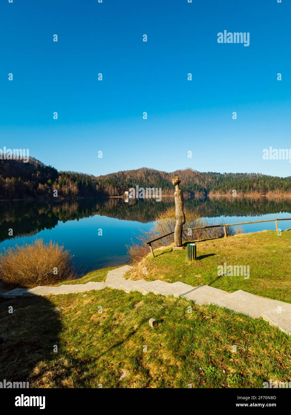 Wooden statue sunshine sunny sunlight Lokve lake in Croatia Europe Stock Photo