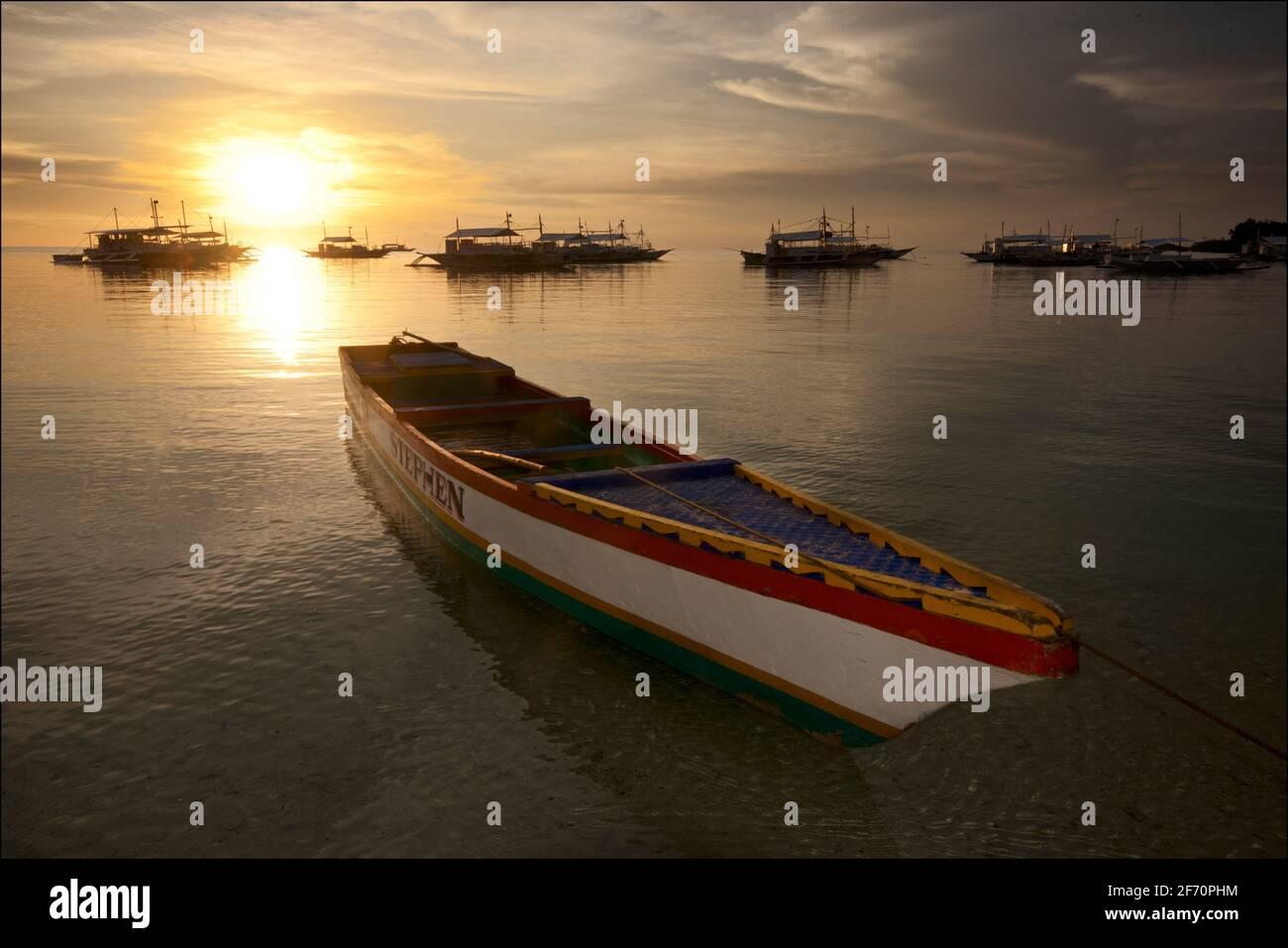 Boat moored off Logon, Malapascua Island at sunset. Visayan Sea, Cebu, Philippines. Stock Photo