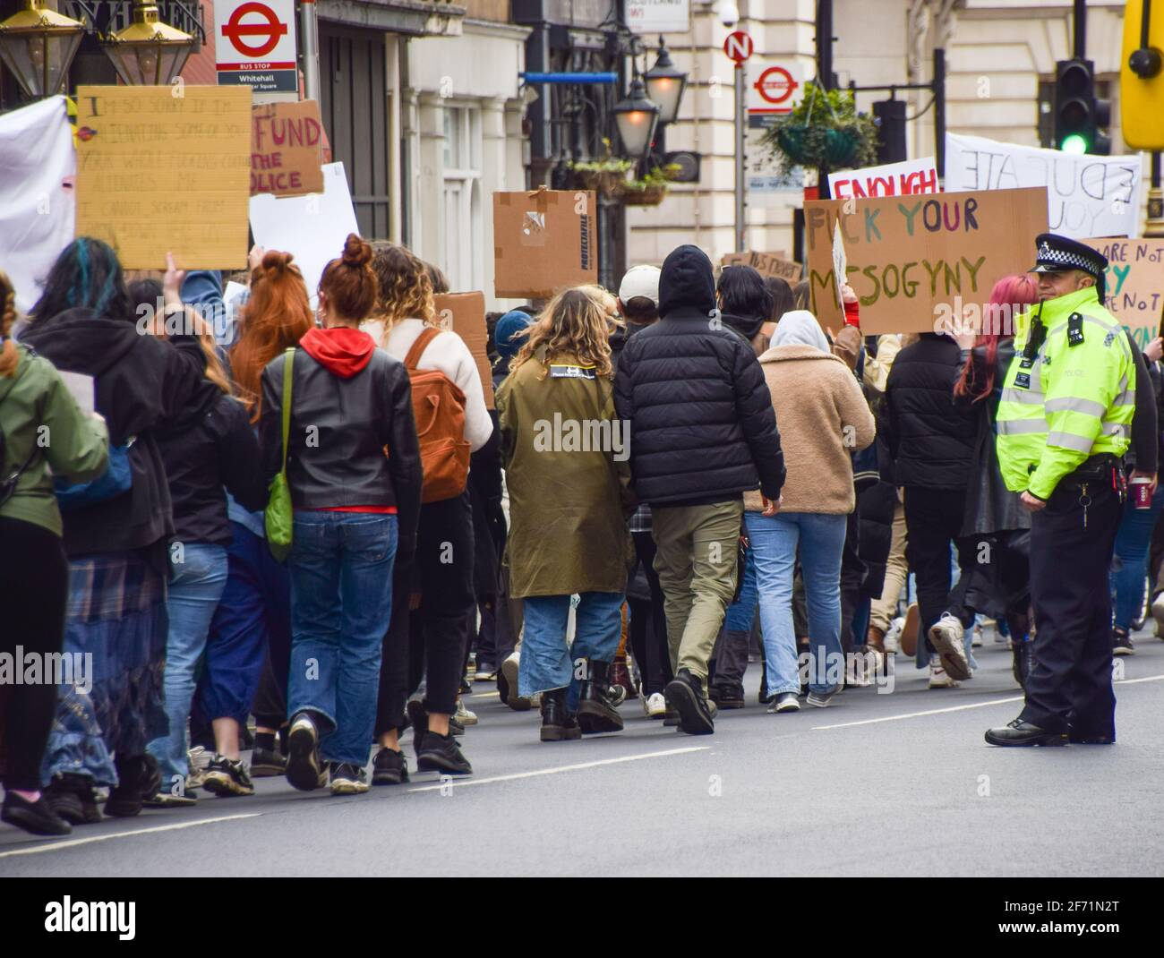 London, United Kingdom. 3rd April 2021. Protesters march down Whitehall towards Parliament Square. Hundreds of demonstrators gathered in Central London for The 97% March to protest against harassment of women. Stock Photo