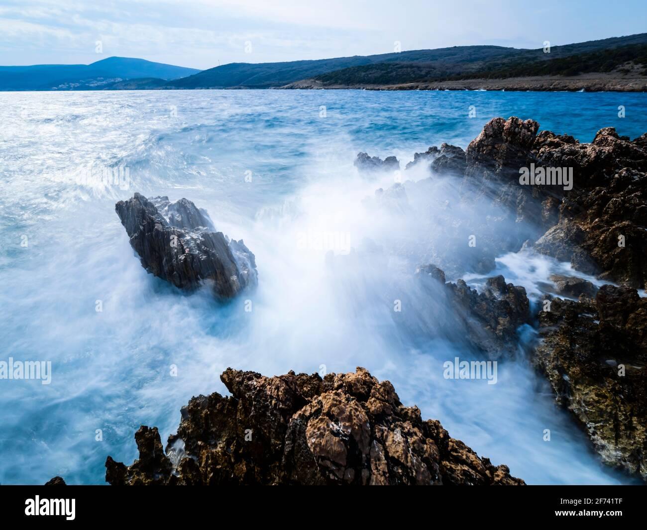 Severe weather high waves rough rocky rocks shore St Marak on Krk island in Croatia Europe long exposure Stock Photo