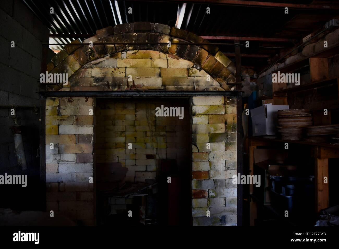 Abandoned pottery shed, looking into a kiln.  Creepy empty building. Stock Photo