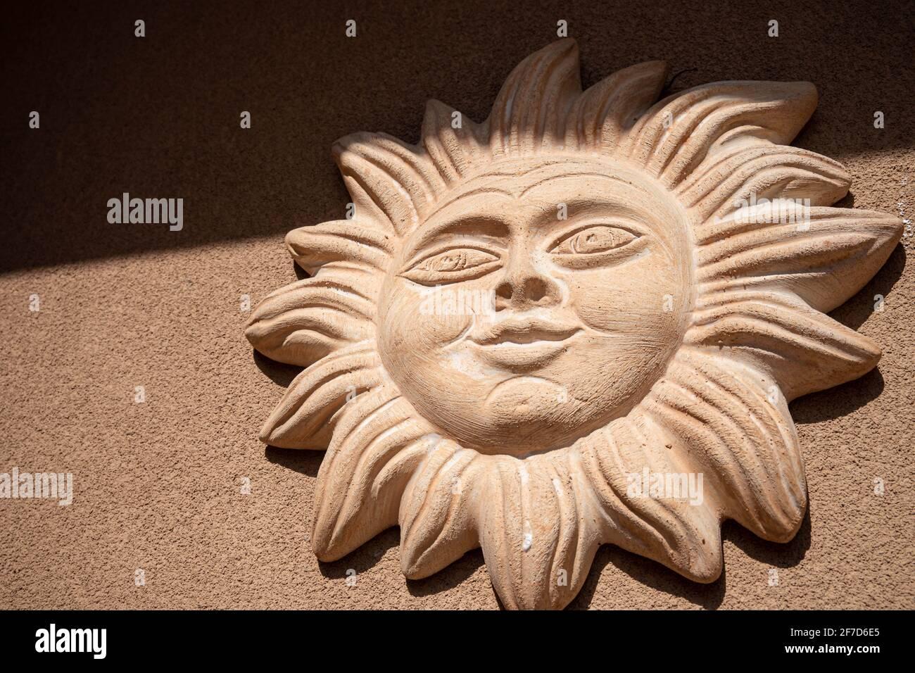 Decorative ceramic sun handmade in Italy. Stock Photo