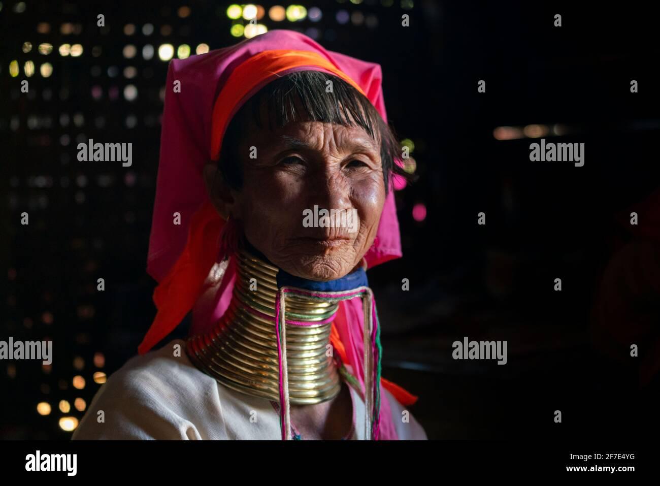 Kayan woman wearing traditional brass neck rings, near Loikaw, Myanmar Stock Photo