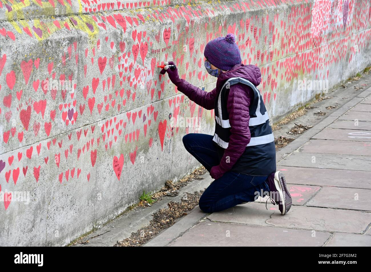 London. UK. Hearts continue to be added to the National Covid Memorial Wall at St. Thomas' Hospital Westminster, in memory of those who have died from coronavirus during the pandemic. Stock Photo