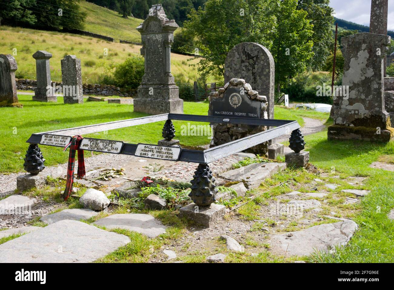 Grave of Rob Roy McGregor at Balquidder Parish Church graveyard, Stirlingshire, Scotland. Buried along is his wife, Helen, and son Coll Stock Photo