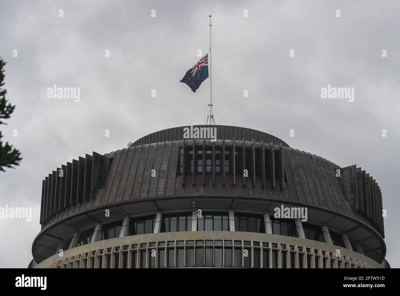 Wellington, Wellington. 10th Apr, 2021. New Zealand national flag flies at half-mast on top of Beehive, the parliament building of New Zealand, to show condolences over death of Britain's Prince Philip, in Wellington, New Zealand on April 10, 2021. Credit: Guo Lei/Xinhua/Alamy Live News Stock Photo