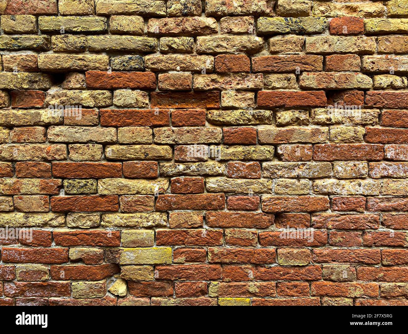 Horizontal part of a Venetian old red brick wall, background, Stock Photo