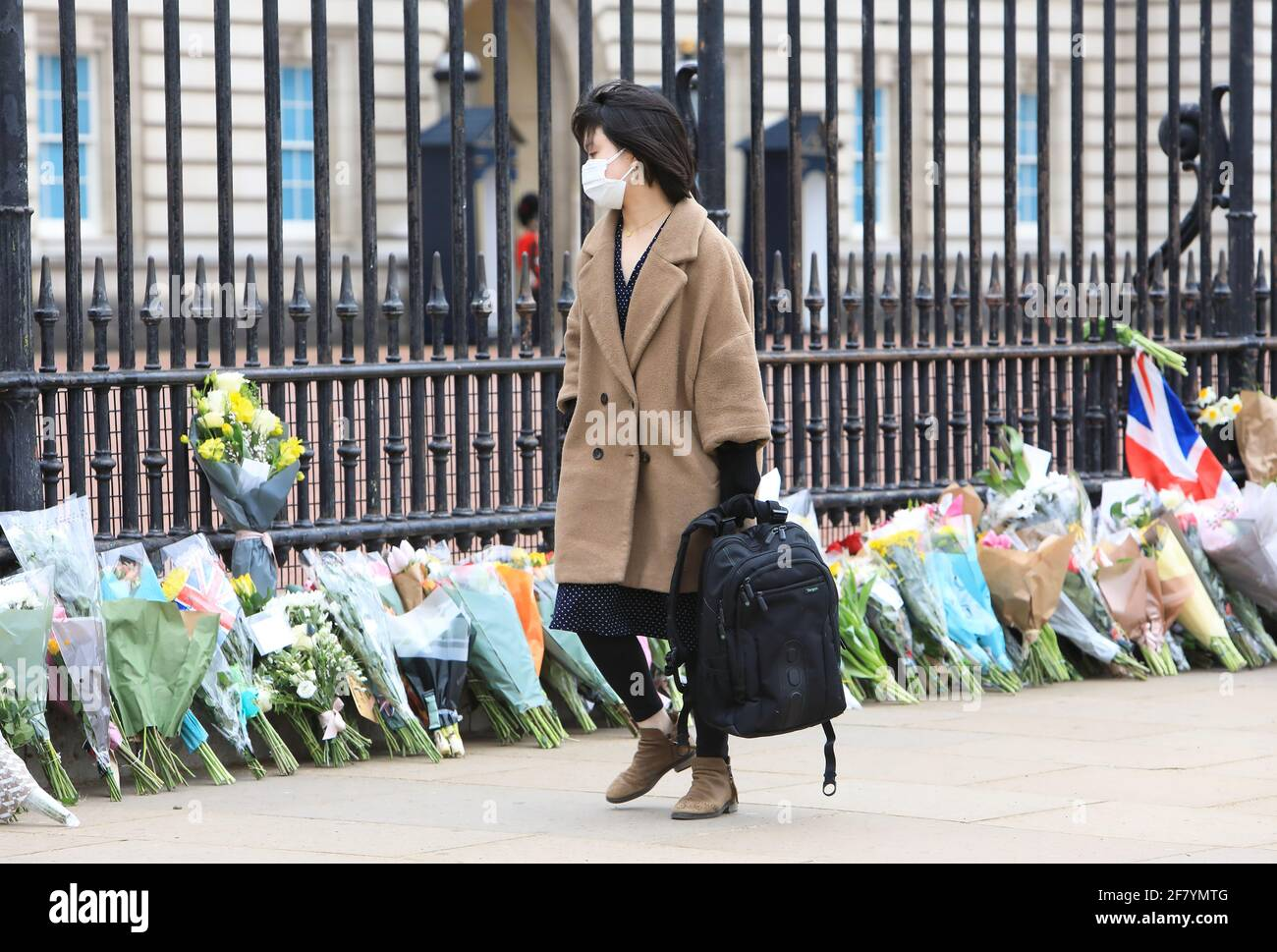 London, UK April 10th 2021. People queued up to lay flowers and pay their respects outside Buckingham Palace in tribute to HRH Prince Philip, who died on Friday at the age of 99, just 2 months short of his 100th birthday. Monica Wells/Alamy Live News Stock Photo