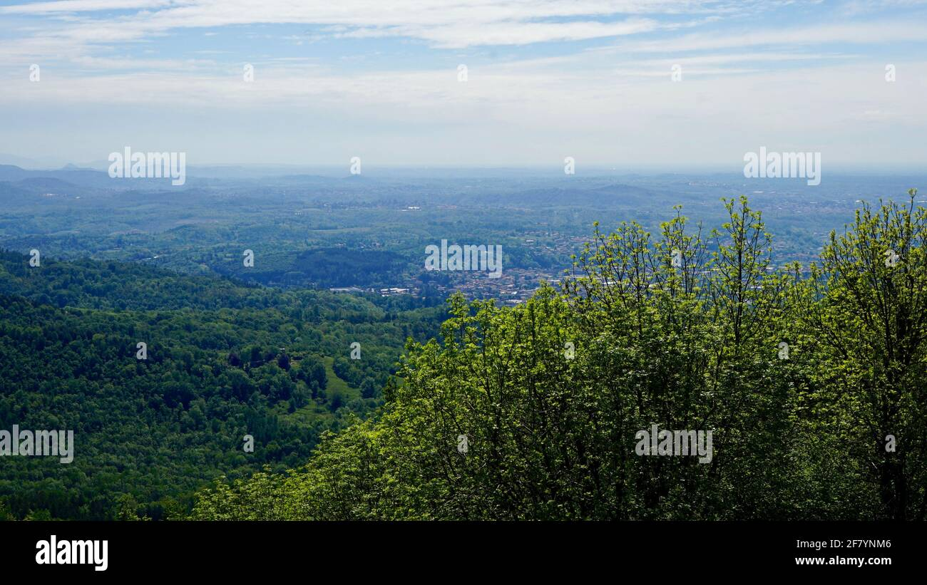 Green mountain of Sacro Monte in a sunny day with blue sky. Stock Photo