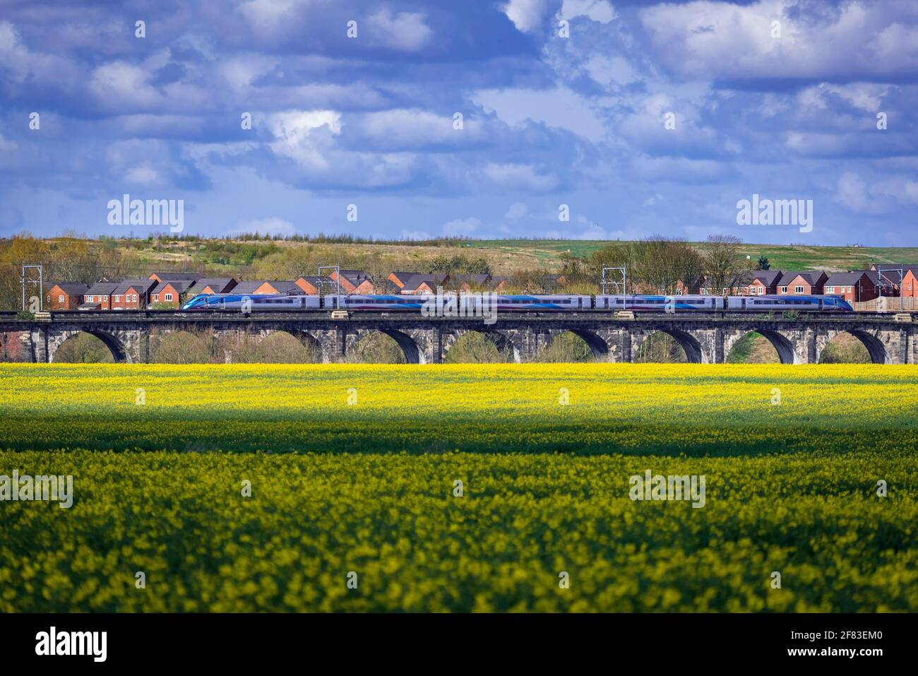 The Sankey Valley viaduct, the first railway viaduct in the world. Trans Pennine express train. Hitachi Class 800 Azuma heading west. Stock Photo