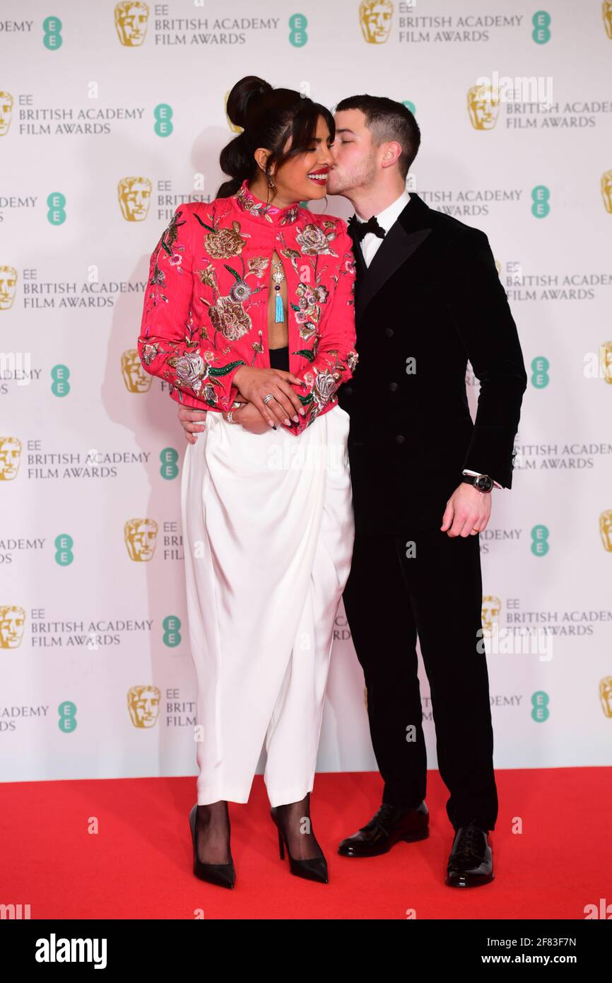 Priyanka Chopra Jonas and her husband Nick Jonas arrives for the EE BAFTA Film Awards at the Royal Albert Hall in London. Picture date: Sunday April 11, 2021. Stock Photo