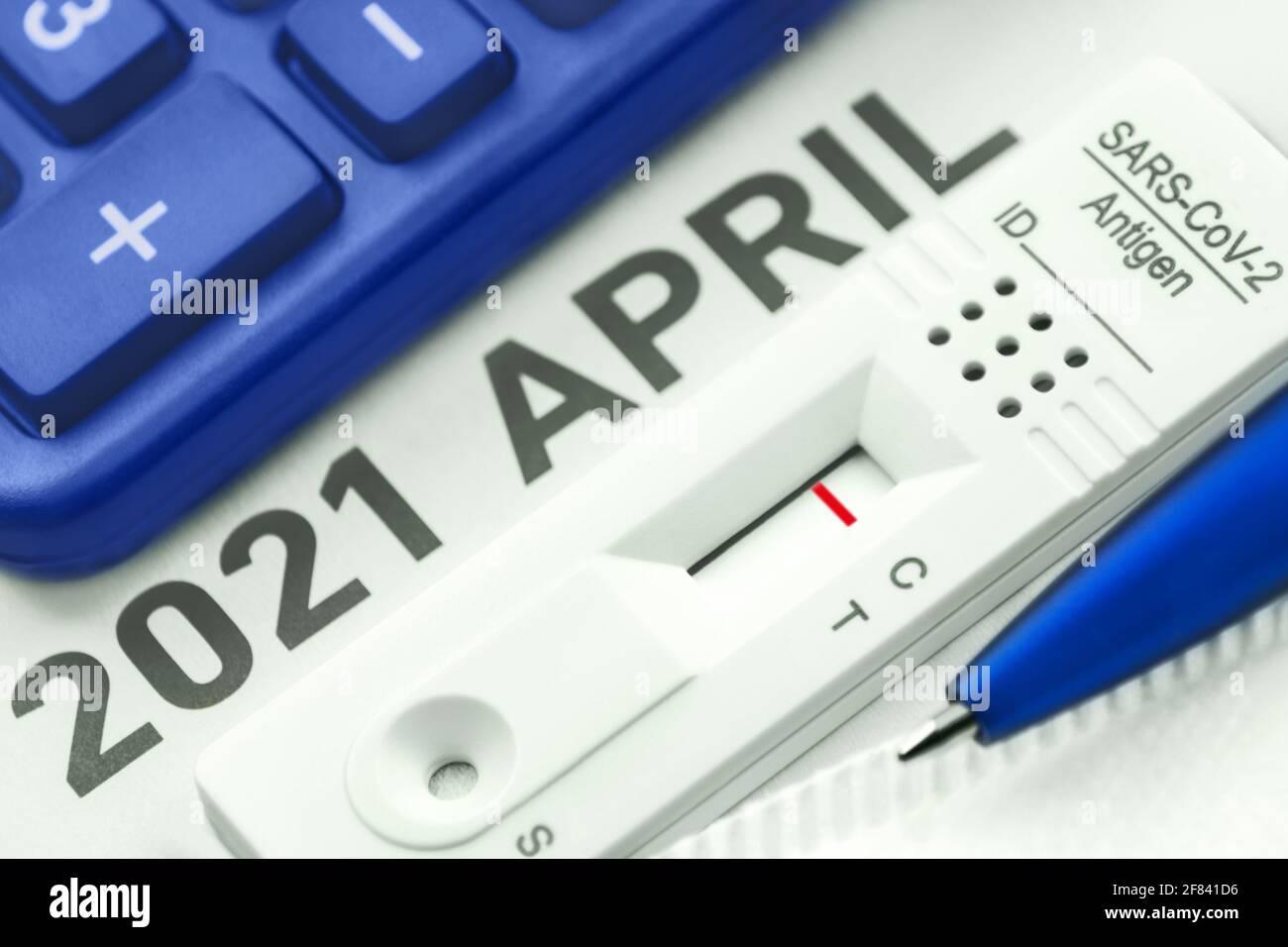 Corona Antigen Rapid Test and calculator Stock Photo